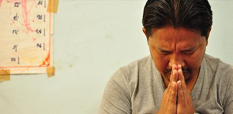 Bhutanese pastor waits