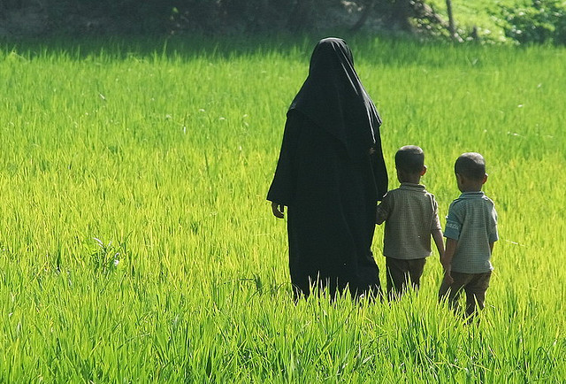 Muslim woman and kids