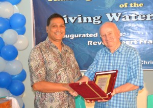 Peter Mazumder at the inauguration of the Living Water Center.  (Screenshot taken from BSFB.org)