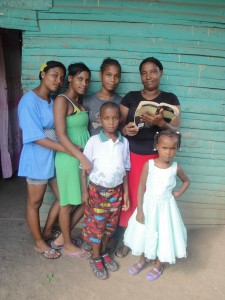 15594-Fidelia-and-family-with-Bible-225x300