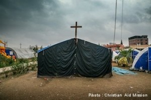 In an Ankawa tent camp, a makeshift chapel even emerged. (Caption/photo by Christian Aid Mission)