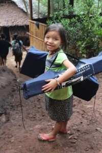 A helper unloading medical equipment pauses for a picture.  (Photo cred: VBB)