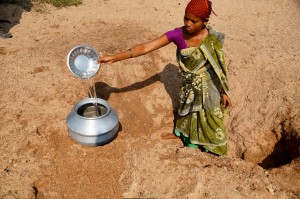 This woman is harvesting water for her family from a dry stream bed.  (Photo courtesy: India Partners/John Sparks)