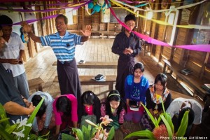 Indigenous pastors pray over their congregation.  (Photo courtesy of Christian Aid Mission)