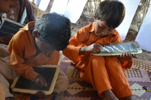 School boys writing on boards (Photo, caption courtesy of Digni Norge via Flickr) CC2.0