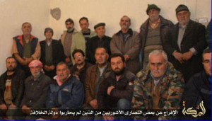 ISIS member addresses the Assyrian hostages from Tel Goran at an unknown location (photo: social media via aina.org).