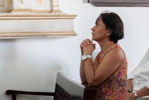 Woman praying in Cristo buen Viaje Church