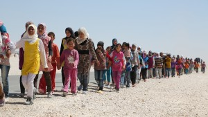 Syrian children march in the refugee camp in Jordan.  (Photo © 2013 IMB / IMB file photo)