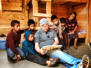 Dick from Shepard of the Bay sharing the gospel with Manuela and her family. (Photo, caption courtesy of Pray America via Facebook)