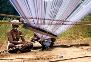 A weaver in India prepares his thread.  (Photo courtesy Wikipedia)