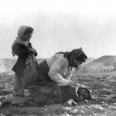 "Armenian woman kneeling beside dead child in field ""within sight of help and safety at Aleppo""  (Caption, photo courtesy Wikipedia)"