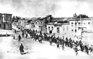 Armenians are marched to a nearby prison in Mezireh by armed Turkish soldiers. (Photo, caption courtesy Wikipedia)