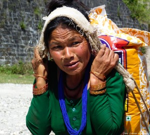 A woman who lost her home in Lamosangu village, in Nepal's Sindhupalchowk District, carries the first package of earthquake aid she had seen since the April 25 quake. (Photo, caption courtesy Christian Aid Mission)