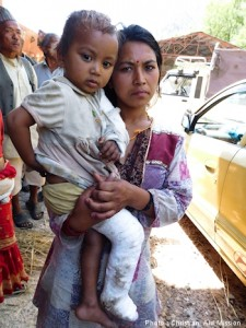 Mother and child awaiting relief items in Lamosangu village, Sindhupalchowk District.  (Photo, caption courtesy Christian Aid Mission)