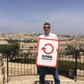 Werner Nachtigal promoting the Global Outreach Day in Jerusalem.  (Photo, caption courtesy Global Outreach Day via FB)