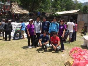 International Needs Nepal Team in village distributing food.