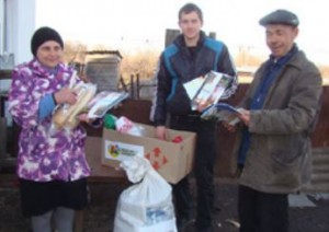 Family in Ukraine received food and God's Word as they flee violence. (Photo courtesy of Mission Eurasia)