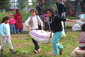 Children help offload aid at a tent camp for refugees in Turkey.  (Image, caption courtesy Christian Aid Mission)
