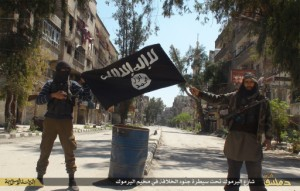 "A photo posted on internet on April 7, 2015 shows ISIS or Daesh (Daech) or ""Islamic State"" group militants posing in Yarmouk (Yarmuk) Palestinian camp, located in a suburb of Damascus, Syria, that is partially now under their control.  (Photo by Balkis Press/Sipa USA, obtained via PrayForISIS.com)"