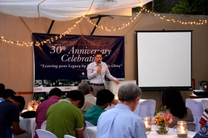 ABTS Dean Jim Blumenstock prays at anniversary celebration in the Philippines.