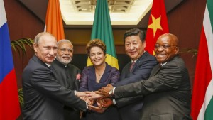 BRICS heads of state and government hold hands ahead of the 2014 G-20 summit in Brisbane, Australia. (Photo, caption courtesy Roberto Stuckert Filho via Wikipedia)