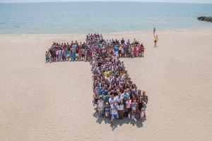 Kids form a cross at the Azov Sea