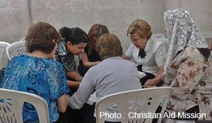 In Aleppo, Syrian Christians pray amid ravages of war.  (Photo, caption courtesy Christian Aid Mission)