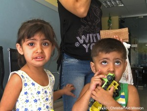 Two of the many children in Syria who have seen the horrors of war take comfort in weekly Christian programs, and they find trustworthy friends in the volunteers who organize activities with the help of local churches.  (Photo, caption courtesy Christian Aid Mission)