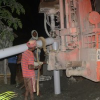 The drill worked late into the evening until it reached safe water for the well. (Photo courtesy of India Partners)