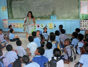 Gina teaching children about Jesus at a public school