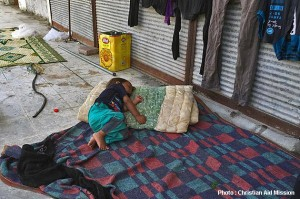 A Syrian refugee child is forced to sleep on a street in Turkey. (Photo and caption courtesy of Christian Aid Mission)