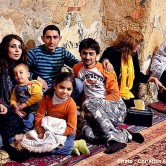 Surviving Syrian refugee family members hold close to one another. (Photo and caption courtesy of Christian Aid Mission)