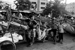 Exhibited at a child labour exhibition at the Foreign Correspondents Club of Thailand (FCCT), this photo shows subjects affected by the issue of child labour. (© ILO/Jeffrey Leventhal shared via CreativeCommons)