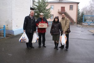 Delivering supplies provided through Crisis Evangelism Fund. (Photo courtesy SGA)