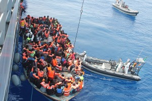 Irish Naval personnel from the LÉ Eithne (P31) rescuing migrants as part of Operation Triton. (Wikipedia)