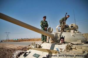 Kurdish soldiers prepare for battle outside Kirkuk in northern Iraq.  (File photo, Boris Niehaus, Wikimedia obtained via Christian Aid Mission)