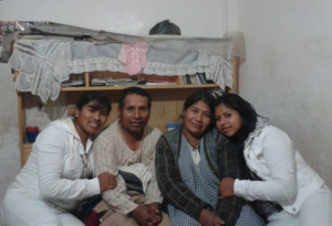 (Photo Courtesy Food for the Hungry) Mayra sits with her family. (Left to right: Mayra, her father, mother, and sister.)