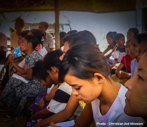 Entire families listen to gospel preaching at a house church in Burma (Myanmar). (Photo, caption courtesy Christian Aid Mission)