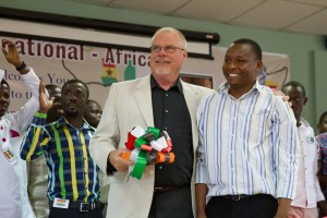 Former President Mike Buus pictured here with one of DOOR's Africa translators. (Photo courtesy The Myers Chronicles)