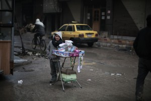 On 5 January, during a school day, 9 year-old Ayman sells candies in the streets of Kafar Batna village in Rural Damascus. (Photo, caption courtesy UNICEF)