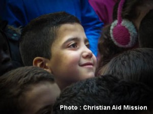 A children's program organized by an indigenous ministry in Syria brings a smile to a little one. (Photo, caption courtesy Christian Aid Mission)
