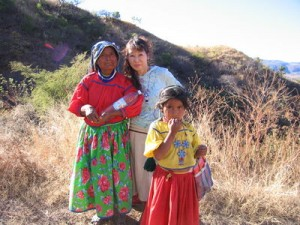Photo of Wixarika (Huichol) woman and child on road near Tuxpan de Bolaños (Photo credit: Arturo Ramos via Wikipedia)