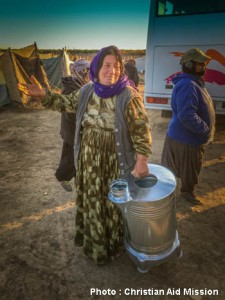 CAM_refugee woman getting heater 02-05-16
