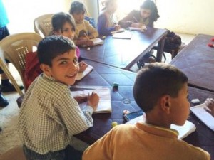 (Photo refugee class, courtesy Tent Schools International)