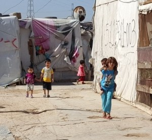 (Photo Syrian refugee camp, courtesy Tent Schools International)