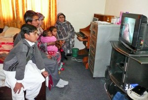 Members of a family of persecuted Christians watches the JESUS Film during their stay at one of the Kerith Brook shelters in Pakistan. This network of safe house is named after the place where the Lord miraculously sheltered and sustained the Old Testament prophet Elijah during a time of crisis. (Photo, caption courtesy FMI)