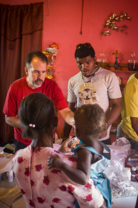 Barry Ewy with malaria patients. (Photo courtesy Blessings Int'l)