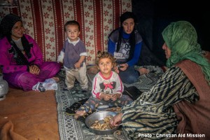 A family shares an afternoon meal of peanuts in a makeshift refugee camp in Adana, Turkey. (Photo courtesy Christian Aid Mission)