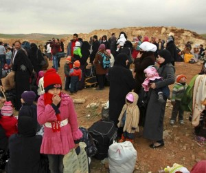 (Photo Courtesy GAiN) Syrian refugees and their families rest after crossing from Syria into Jordan near Mafraq, to escape violence in Syria, February 18, 2013. REUTERS/Muhammad Hamed