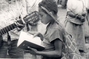 """""""An Oksapmin girl reading a New Testament in her own language in Papua New Guinea!"""" (Photo and caption courtesy of Wycliffe Bible Translators via Facebook)."""
